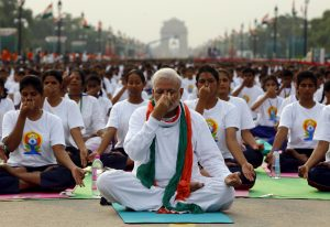 India's Prime Minister Narendra Modi performs yoga with others during a yoga camp to mark the International Day of Yoga, in New Delhi, India, June 21, 2015. REUTERS/Adnan Abidi      TPX IMAGES OF THE DAY      - RTX1HFBE